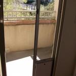 Pet Door panel for sliding screen door
