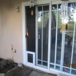 Pet Door panel for sliding screen door