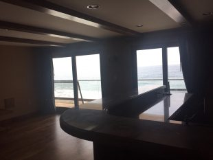 Screen doors installed in entertainment bar room in Malibu home