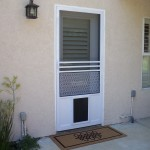 Pet Door installed on swinging screen door