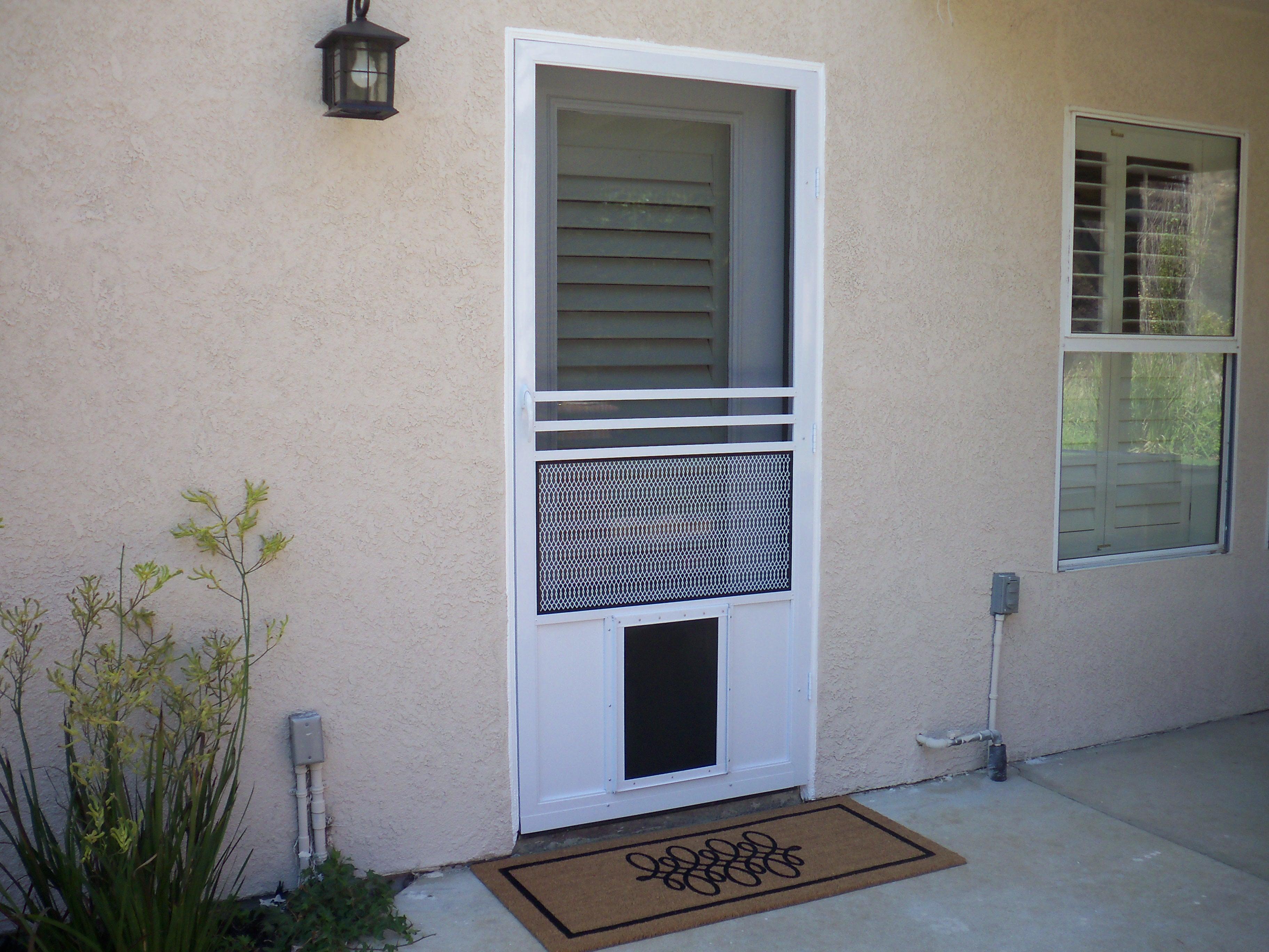 Pet Door installed on swinging screen door