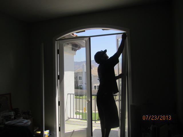 Installation of Arched Screens For Double Set French Doors in Encino
