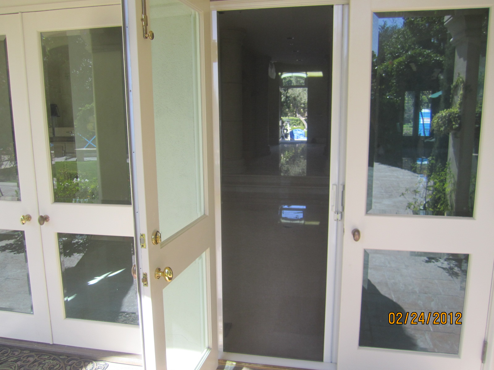 Hide away screen doors installed bell air retractable for What is the best retractable screen door