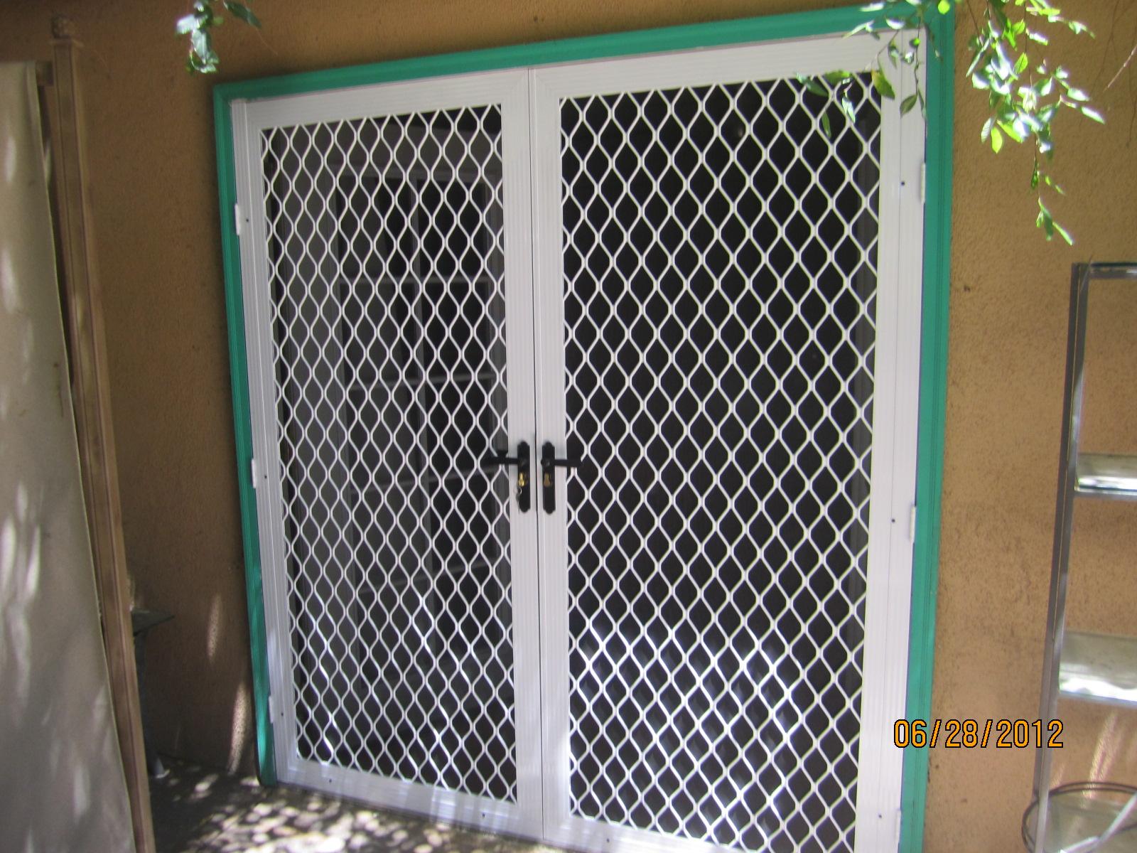 Double set of security screen doors in northridge for Hideaway screens for french doors