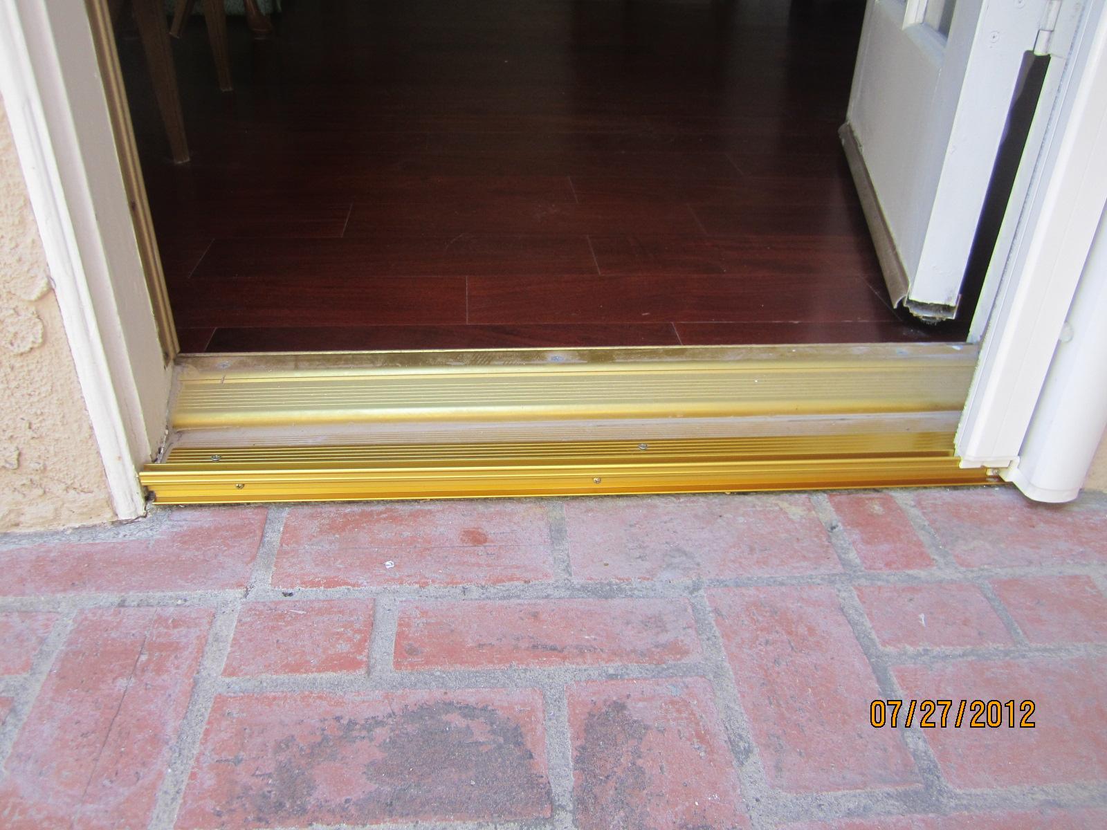 Single swinging door threshold after installation in for Door threshold