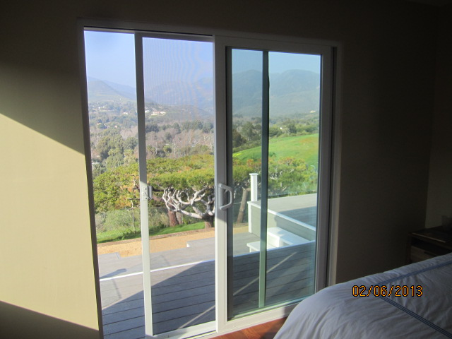 Screen doors malibu new ocean front install on condo for Balcony sliding screen door